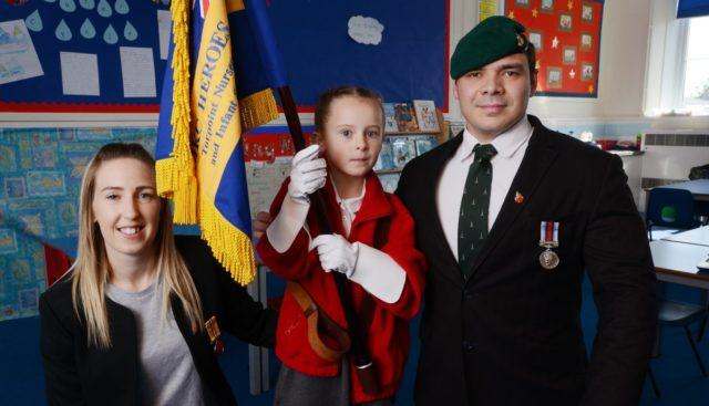 Mollie Stonelake with her parents Donna and Mark Stonelake, who have both served in the Armed Forces (Royal British Legion/PA)