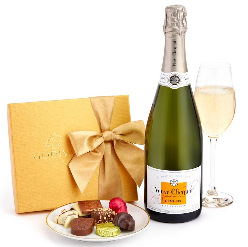 """<h2>Veuve Clicquot Demi-Sec & Godiva Chocolates Gift Set</h2> <br>And if you do decide to go the ol' classic bottle-of-bubbly route, then at least pair it with a sweet gift box of Godiva chocolates.<br><br><em>Shop <strong><a href=""""https://www.wine.com/list/gifts/7151"""" rel=""""nofollow noopener"""" target=""""_blank"""" data-ylk=""""slk:Wine.com"""" class=""""link rapid-noclick-resp"""">Wine.com</a></strong></em> <br><br><strong>Multiple Brands</strong> Veuve Clicquot Demi-Sec & Godiva Chocolates Gift Set, $, available at <a href=""""https://go.skimresources.com/?id=30283X879131&url=https%3A%2F%2Fwww.wine.com%2Fproduct%2Fveuve-clicquot-demi-sec-and-godiva-chocolates-gift-set%2F90621"""" rel=""""nofollow noopener"""" target=""""_blank"""" data-ylk=""""slk:Wine.com"""" class=""""link rapid-noclick-resp"""">Wine.com</a><br><br><br>"""
