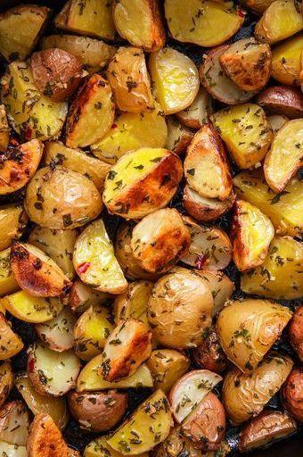 """<p>Is there anything better than a perfectly roasted potato? The test kitchen can devour a large pan of them like it's nothing and feel no shame.</p><p>Get the <a href=""""https://www.delish.com/uk/cooking/recipes/a28786247/herb-roasted-potatoes/"""" rel=""""nofollow noopener"""" target=""""_blank"""" data-ylk=""""slk:Herb Roasted Potatoes"""" class=""""link rapid-noclick-resp"""">Herb Roasted Potatoes</a> recipe.</p>"""