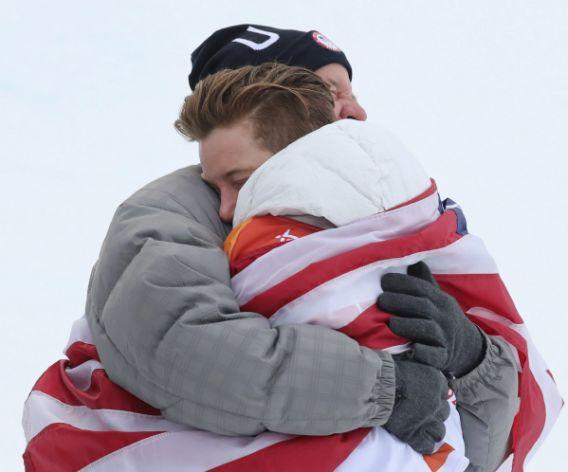 <p>Shaun White embraces his father after winning his third Olympic gold medal. White laid down a massive third run to overtake Ayumu Hirano of Japan. </p>
