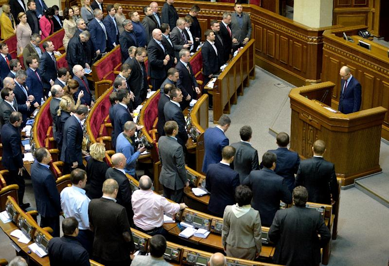 "A group of Ukrainian lawmakers had earlier Monday disrupted the parliament to block the vote on the constitutional reforms, which they condemned as ""anti-Ukrainian"" and ""pro-Vladimir Putin (AFP Photo/Sergei Supinsky)"