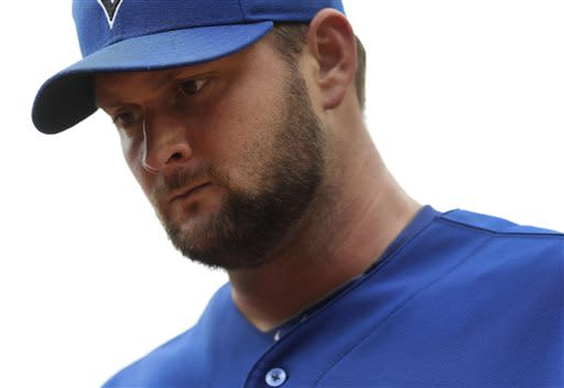 Toronto Blue Jays starting pitcher Todd Redmond walks off the field after the fourth inning of a baseball game, Saturday, July 13, 2013, in Baltimore. Redmond allowed two runs to score in the fourth, and he did not return to the game in the fifth. (AP Photo/Patrick Semansky)