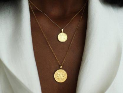 "This Black-owned Canadian Etsy shop specializes in stunning pendant necklaces with a variety of designs and illustrations. Shop the <a href=""https://fave.co/2A5VlJ1"" target=""_blank"" rel=""noopener noreferrer"">Double Up coin necklace stack in gold vermeil for $187</a> at <a href=""https://fave.co/3csRWRG"" target=""_blank"" rel=""noopener noreferrer"">OmiWoods on Etsy.</a>"