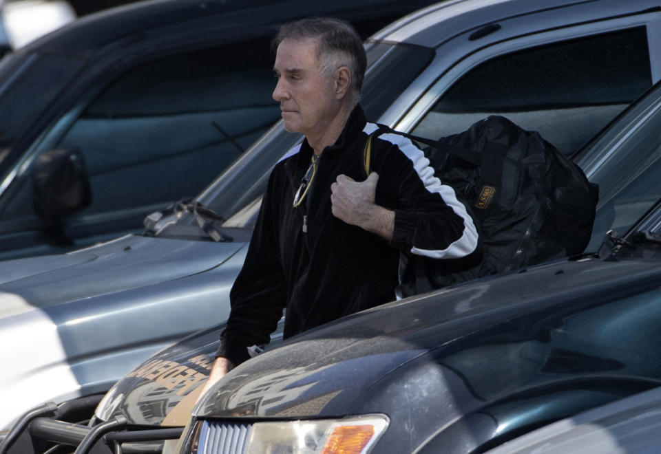 Brazilian businessman Eike Batista arrives at the Federal Police headquarters after being arrested on corruption charges related to the