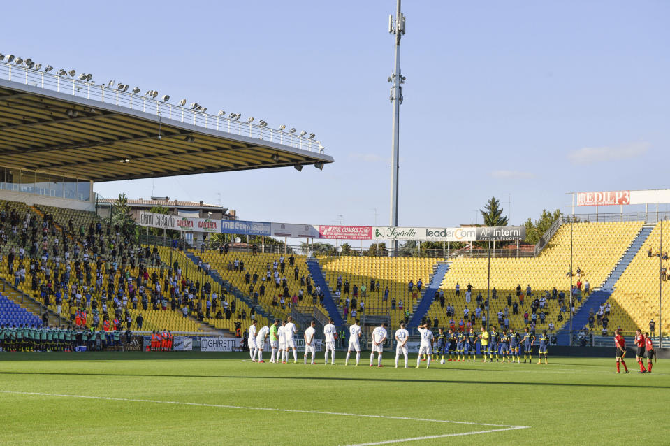 Fans wait for the start of a friendly match between Parma and Empoli at the Ennio Tardini stadium in Parma Sunday, Sept. 6, 2020. For the first time since the start of the COVID-19 pandemic, the stadium was opened for 1,000 fans. (Massimo Paolone/LaPresse via AP)