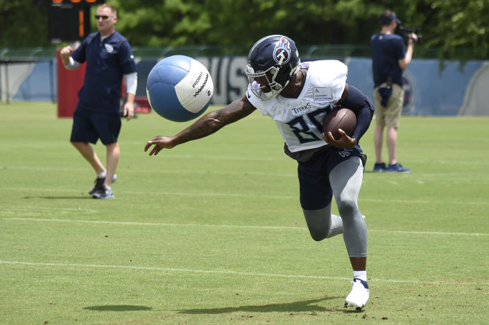 Titans wide receiver Chester Rogers (80) knocks down a heavy ball as he runs a drill during NFL football training camp Thursday, May 27, 2021, in Nashville, Tenn. (George Walker IV/The Tennessean via AP, Pool)