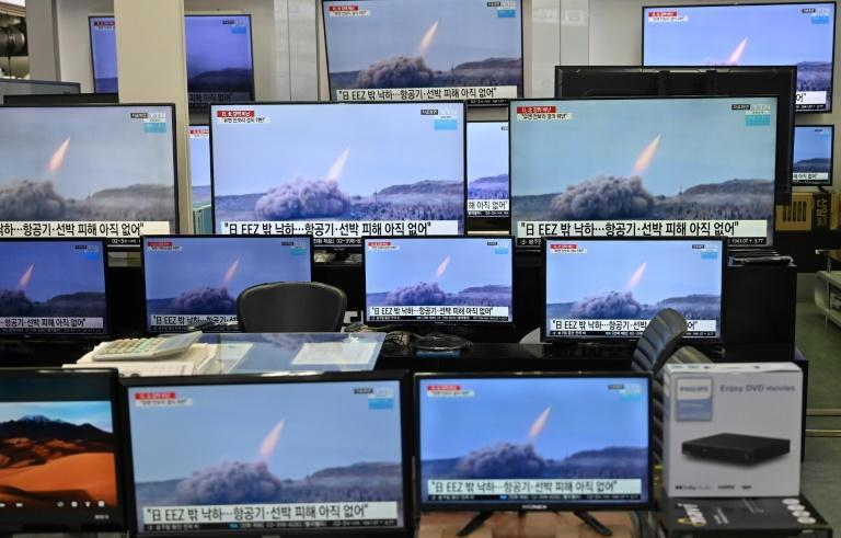 Televisions at a supermarket in Seoul show footage of two North Korean ballistic missile tests