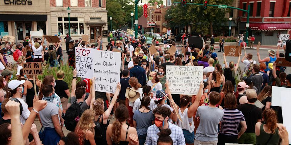 Protesters shutdown the intersection of Kirkwood and Walnut Street in Bloomington, Indiana, during the demonstration. Protesters are demanding justice for Vauhxx Booker, who was allegedly attacked at Lake Monroe on Saturday the 4th of July 2020.
