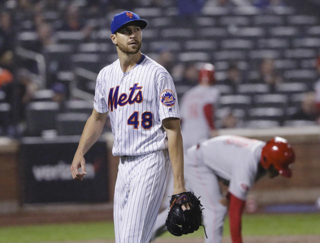 New York Mets starting pitcher Jacob deGrom leaves the field during the seventh inning of the team's baseball game against the Cincinnati Reds on Wednesday, May 1, 2019, in New York. The Reds won 1-0. (AP Photo/Frank Franklin II)
