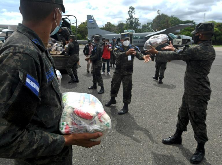 Honduran Air Force members load supplies on planes, to be taken to residents of Puerto Lempira municipality, department of Gracias a Dios, in preparation for the arrival of the upcoming Hurricane Eta, in Tegucigalpa, on November 2, 2020