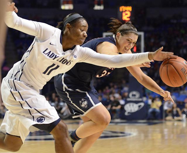 Penn State's Alex Harris (11) and Connecticut's Stefanie Dolson (31) go after a loose ball in the second half of an NCAA college basketball game on Sunday, Nov. 17, 2013, in State College, Pa. Connecticut won 71-52. (AP Photo/John Beale)