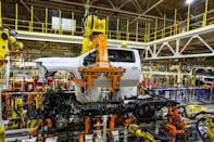 Robots swing a cab and bed into place for a new heavy duty pickup truck on the assembly line where Chevrolet Silverado trucks are being built at General Motors Flint Assembly in Flint, Michigan, U.S., January 30, 2019 John F. Martin/Chevrolet/Handout via REUTERS