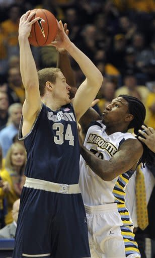 Georgetown 's Nate Lubick (34) is defended by Marquette 's Jae Crowder during the first half of an NCAA college basketball game Saturday, March 3, 2012, in Milwaukee. (AP Photo/Jim Prisching)