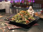 """<p><strong>Where to Get It: </strong>Yak & Yeti Restaurant at Animal Kingdom ($16.99) <strong>Lou's Review: </strong>""""These are a true hidden treasure. I am a <em>huge</em> sushi fan, and never met a nacho I didn't like, and although the pairing of these two items never occurred to me before, they dance together like an artful ballet. The sushi-grade tuna is seared perfectly and placed on a bed of Asian slaw, and topped with crispy fried wontons, wasabi aioli, and a sweet soy glaze that I wanted to bottle up and take home. It's gargantuan and can easily be shared by the whole table (or in my case, just me).""""</p>"""