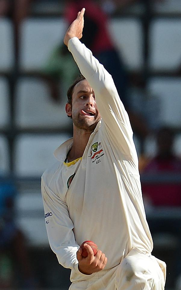 Australian bowler Nathan Lyon makes a delivery during the second day of the third test match between the West Indies and Australia in Roseau, on April 24, 2012. Australia is leading the three-test series 1-0.  TOPSHOTS /  AFP PHOTO / EMMANUEL DUNAND (Photo credit should read EMMANUEL DUNAND/AFP/Getty Images)