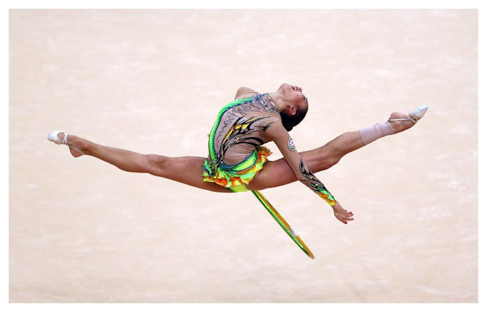 <p>For women's gymnastics, it's all about the leotard. While artistic gymnastics uniforms can be also be flashy, rhythmic gymnastics uniforms have revealing flesh-toned panels, sparkles, and ruffles galore. </p><p><i>(Photo: Getty Images)</i><br></p>