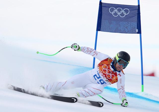 United States' Andrew Weibrecht passes a gate in the men's super-G at the Sochi 2014 Winter Olympics, Sunday, Feb. 16, 2014, in Krasnaya Polyana, Russia. (AP Photo/Alessandro Trovati)