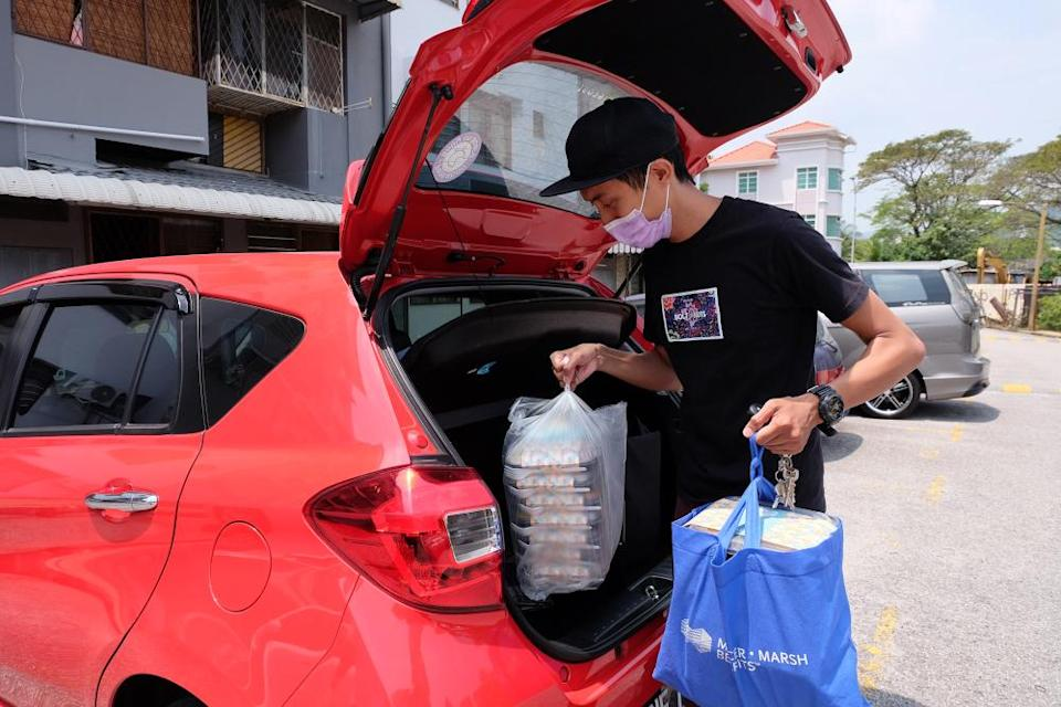 Fandi Khor getting ready to deliver the packed food to customers. — Picture by Steven Ooi KE