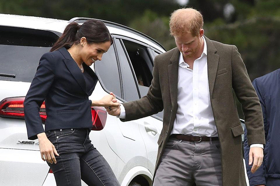 <p>Prince Harry gave his wife a helping hand as they visited Redvale, New Zealand on the third day of their royal tour of the country. </p>