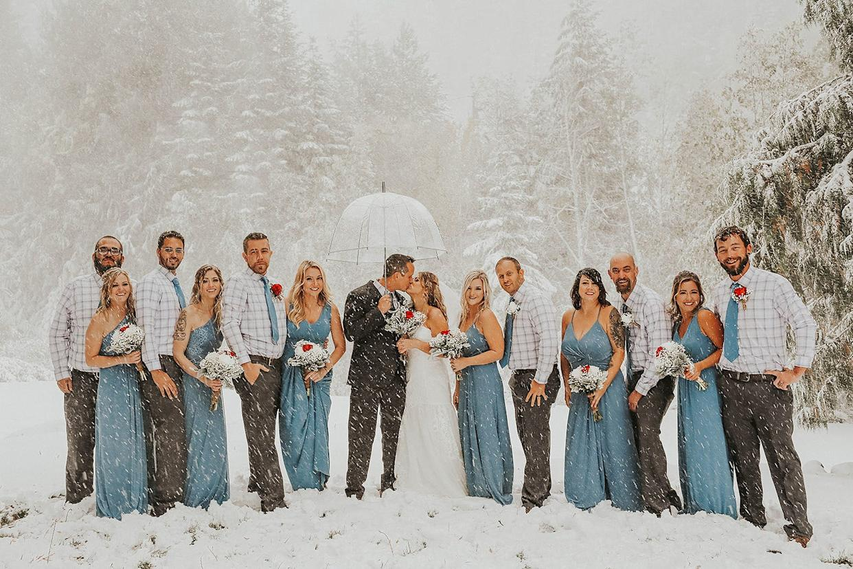 Sean and Brittany Tuohy were planning for an outdoor fall wedding in Washington. Instead, they got hit with a snowstorm on Sept. 28. Photographer Jaime Fletcher captured some unique photos of the occasion.