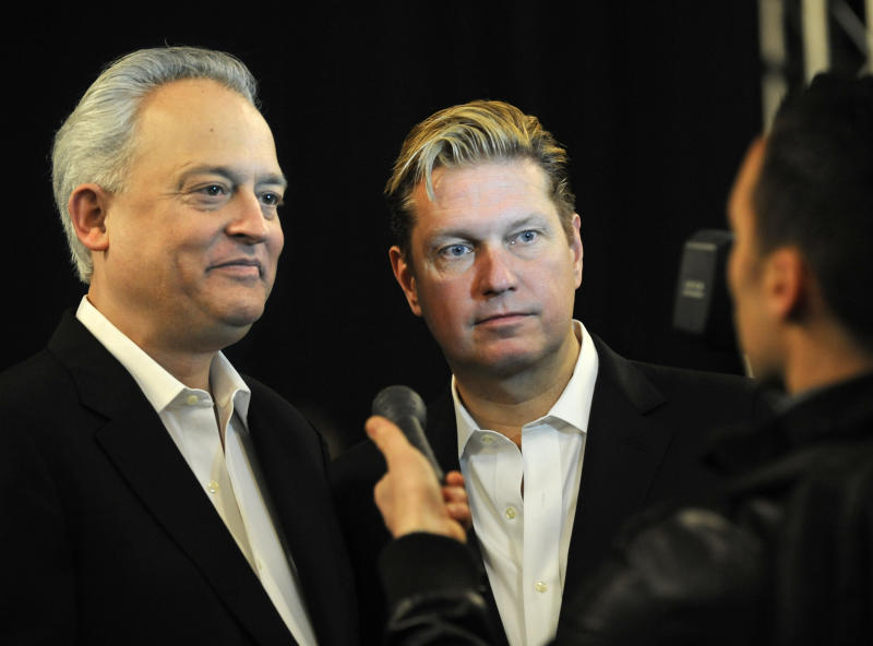 Mark Badgley, left, and James Mischka are interviewed backstage before the showing of their Badgley Mischka Fall 2013 collection during Fashion Week, Tuesday, Feb. 12, 2013, in New York. (AP Photo/Louis Lanzano)
