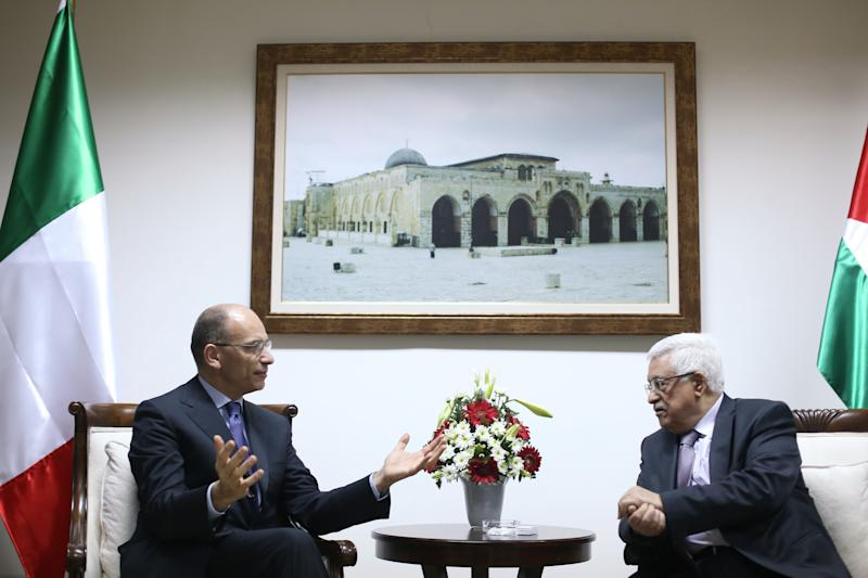 Palestinian President Mahmoud Abbas, right, meets with Italian Prime Minister Enrico Letta upon his arrival in the West Bank city of Ramallah Tuesday, July 2, 2013. (AP Photo/Fadi Arouri, Pool)