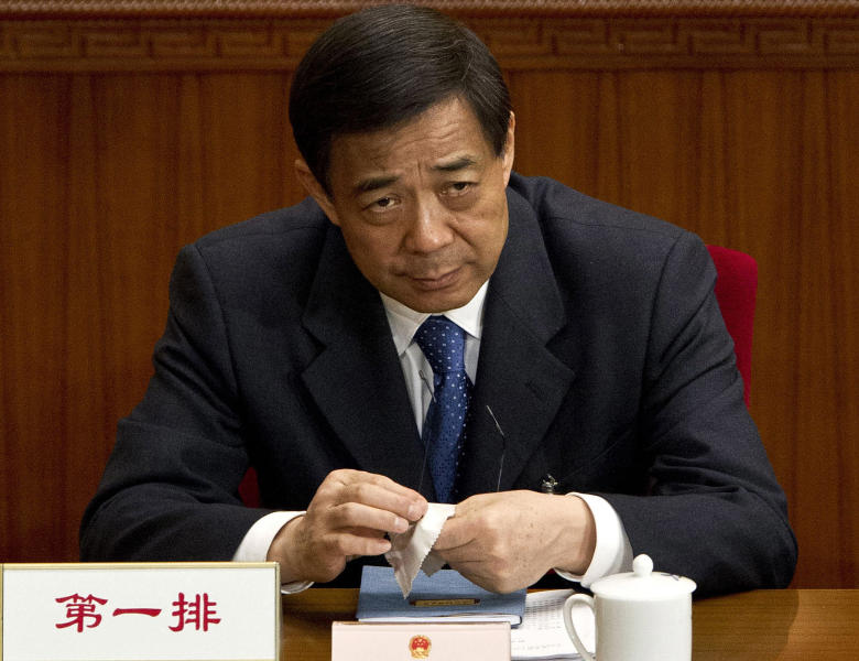 FILE - In this file photo taken on March 11, 2012, Chongqing party secretary Bo Xilai attends a plenary session of the National People's Congress at the Great Hall of the People in Beijing. A Chinese court said Sunday Aug. 18, 2013 that Bo Xilai, a rising Communist Party star who fell from power in a messy scandal, will go on trial Thursday on corruption charges. He was dismissed last year in a sandal that saw his wife convicted of killing a British businessman. (AP Photo/Andy Wong, File)