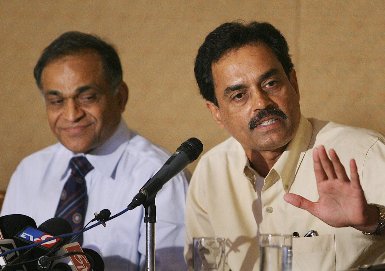 Mohali, INDIA:  Board of Control for Cricket in India (BCCI) newly elected chairman of selectors, Dilip Vengsarkar (R) addresses a press conference as BCCI Secretary, Niranjan Shah (L) looks on in Mohali, 30 October 2006.  Veterans Anil Kumble and Zaheer Khan were recalled to the under-performing Indian team for five one-day internationals scheduled for South Africa in November. The team for the three Test matches to follow will be named later, he added.  AFP PHOTO/Prakash SINGH  (Photo credit should read PRAKASH SINGH/AFP/Getty Images)