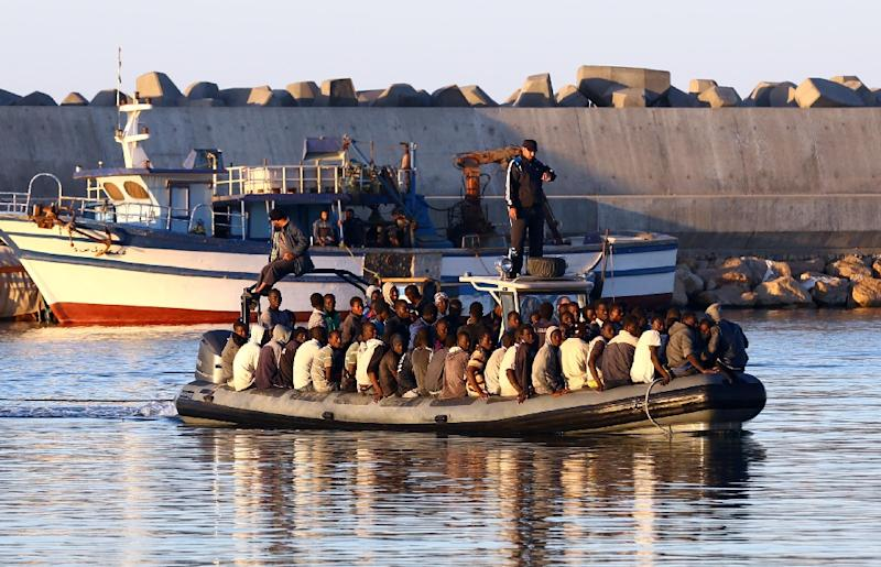 A file picture shows migrants being rescued by the Libyan coastguard after their inflatable boat started to sink off the coastal town of Guarabouli on November 20, 2014