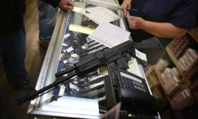 A customer purchases an AK-47 rifle at a sporting goods store in Illinois on Dec. 17.