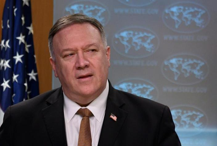Secretary of State Mike Pompeo, seen here in March 2020, says the US can unilaterally reimpose UN sanctions on Iran