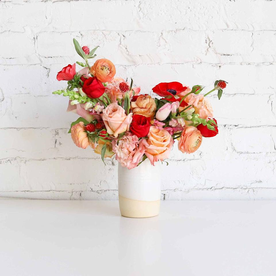 "<p>Flowers galore is the best way to describe this arrangement. A nod to romanticism, this fall design features a mix of roses in reds, oranges, and pink shades.  </p><p><em>Via <a href=""https://farmgirlflowers.com/"" target=""_blank"">Farmgirl Flowers</a></em></p>"