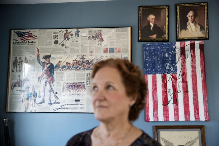 """American Revolutionary War paraphernalia decorates the home of Janet Uhlar, one of 12 jurors who convicted Boston organized crime boss James """"Whitey"""" Bulger, Friday, Jan. 31, 2020, in Eastham, Mass. """"The foundational pillars of the nation, what they built the nation upon, it's all corrupted and collapsing. I think we need to admit we did this,"""" said Uhlar. """"How many people did they do this to? How many came out like Bulger?"""" (AP Photo/David Goldman)"""