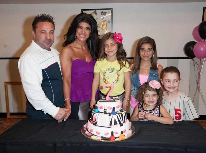 Joe and Teresa Giudice with their four daughters | Dave Kotinsky/Getty Images