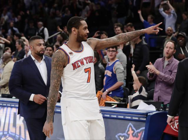 """<a class=""""link rapid-noclick-resp"""" href=""""/nba/players/3706/"""" data-ylk=""""slk:Carmelo Anthony"""">Carmelo Anthony</a> gestures to New York fans after what turned out to be his final game in a Knicks uniform. (AP)"""