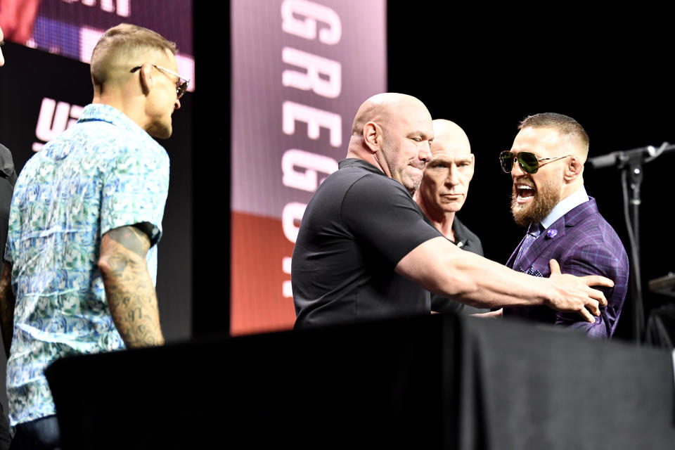 LAS VEGAS, NEVADA - JULY 08: UFC president Dana White separates Conor McGregor (R) of Ireland and Dustin Poirier (L) during the UFC 264 press conference at T-Mobile Arena on July 08, 2021 in Las Vegas, Nevada. (Photo by Chris Unger/Zuffa LLC)