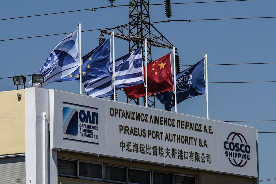 Central offices of Piraeus Port Authority with flags Piraeus Container Terminal operated by COSCO in Piraeus, Greece on August 13, 2018. (Photo by Wassilios Aswestopoulos/NurPhoto via Getty Images)