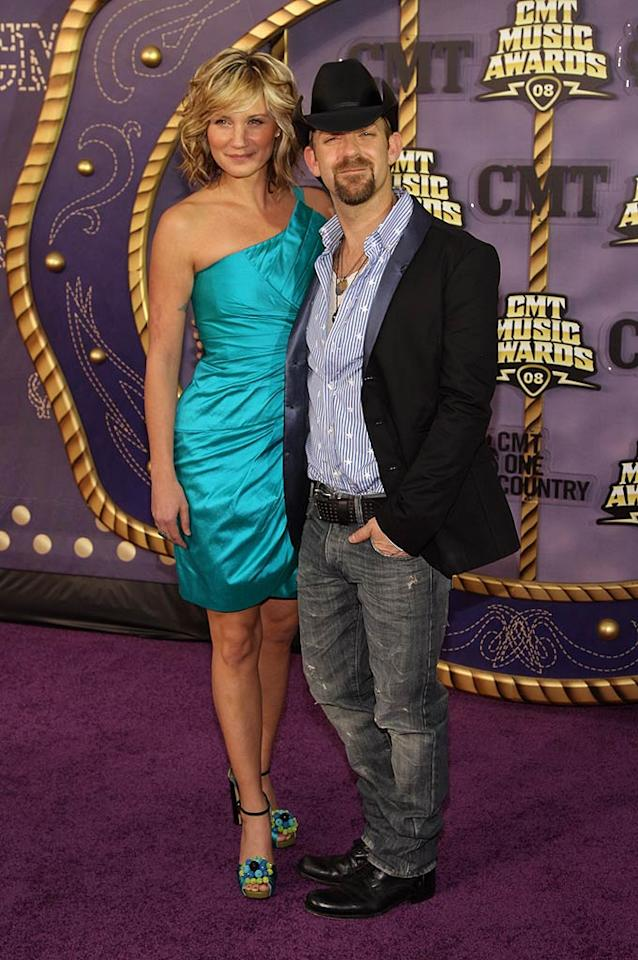 """Sugarland's Jennifer Nettles looked sweet as can be in her turquoise one-shouldered dress, while Kristian Bush dressed up his beat up jeans with a tuxedo jacket. Their band took home top honors for """"Stay,"""" which was named Duo Video of the Year. Steve Lovekin/<a href=""""http://www.gettyimages.com/"""" target=""""new"""">GettyImages.com</a> - April 14, 2008"""