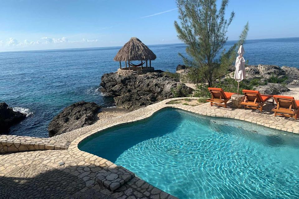 A pool and hut at Tensing Pen, voted one of the best hotels in the world