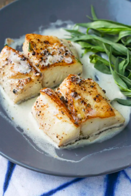 """<p>Get the <a href=""""https://blackberrybabe.com/2020/06/22/pan-seared-cod/"""" rel=""""nofollow noopener"""" target=""""_blank"""" data-ylk=""""slk:Pan Seared Cod with Tarragon Cream Sauce"""" class=""""link rapid-noclick-resp"""">Pan Seared Cod with Tarragon Cream Sauce</a> recipe. </p><p>Recipe from <a href=""""https://blackberrybabe.com/"""" rel=""""nofollow noopener"""" target=""""_blank"""" data-ylk=""""slk:Blackberry Babe"""" class=""""link rapid-noclick-resp"""">Blackberry Babe</a>. </p>"""