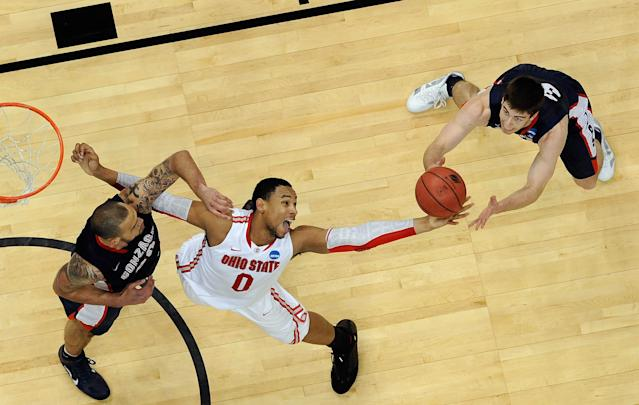 PITTSBURGH, PA - MARCH 17: Jared Sullinger #0 of the Ohio State Buckeyes reaches for a rebound against Robert Sacre #00 (L) and Mike Hart #30 of the Gonzaga Bulldogs during the third round of the 2012 NCAA Men's Basketball Tournament at Consol Energy Center on March 17, 2012 in Pittsburgh, Pennsylvania. (Photo by Gregory Shamus/Getty Images)