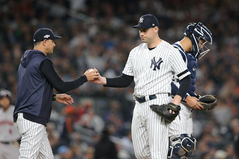 Oct 15, 2019; Bronx, NY, USA; New York Yankees relief pitcher Adam Ottavino (0) hands the ball to manager Aaron Boone (17) during the fifth inning of game three of the 2019 ALCS playoff baseball series against the Houston Astros at Yankee Stadium. Mandatory Credit: Brad Penner-USA TODAY Sports