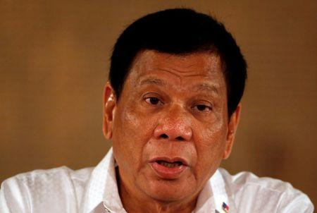 FILE PHOTO: Philippine President Rodrigo Duterte speaks during a news conference at the presidential palace in Manila