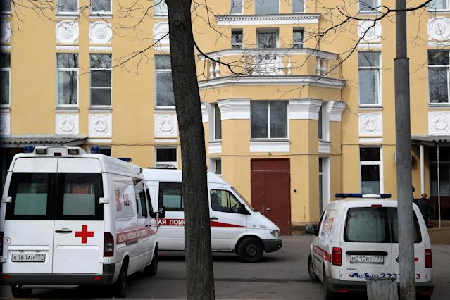 Ambulance vehicles at Infectious Diseases Hospital 2 in Moscow, Russia, where a 79-year-old woman infected with coronavirus died from pneumonia. (Getty Images)