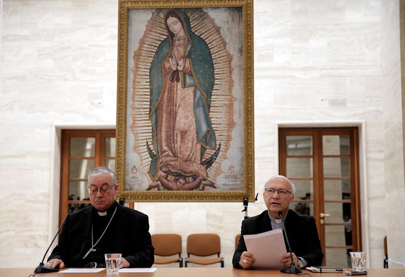 Chilean bishops Luis Fernando Ramos Perez and Juan Ignacio Gonzalez Errazuriz read statements during a news conference after meeting with Pope Francis at the Vatican on May 18. (Max Rossi / Reuters)