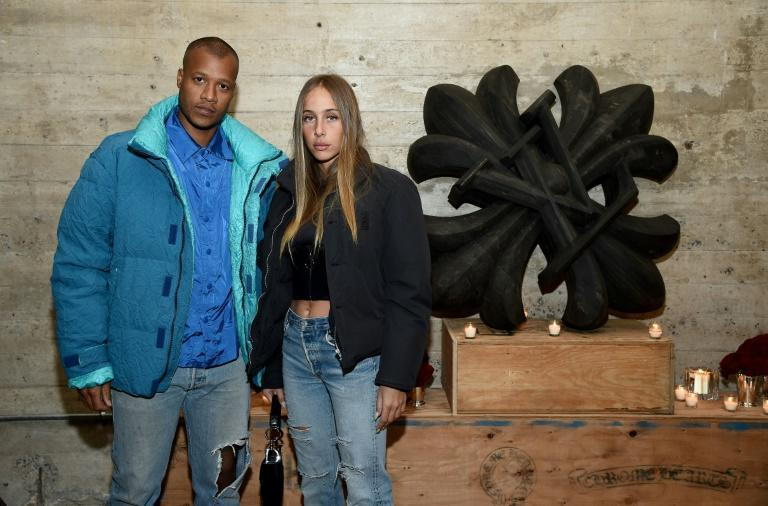 DJ-turned-designer Heron Preston, seen here with Sabrina Albarello is one of a wave of young designers taking streetwear upmarket
