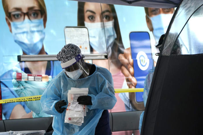 A health care worker works at a walk-up COVID-19 testing site, Wednesday, Nov. 18, 2020, in Miami. Florida health officials have reported a steady increase in the number of new coronavirus cases each day over the past month and a half, though the numbers are no where near the peak in July. (AP Photo/Lynne Sladky)