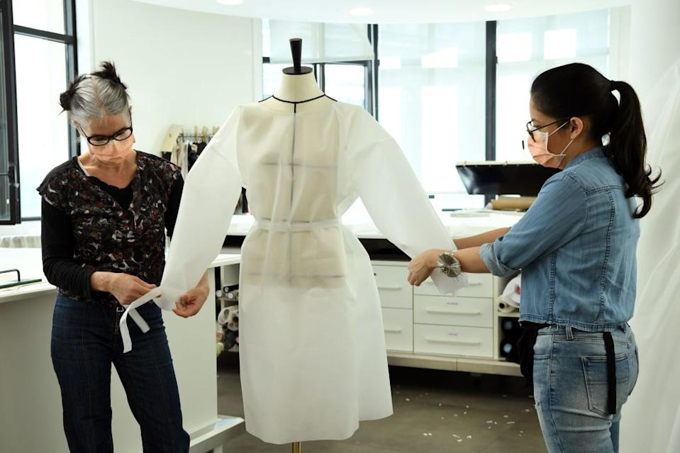 Two seamstresses from Louis Vuitton put together a coat-jacket to be worn by nurses helping to treat those with coronavirus. (Getty Images)