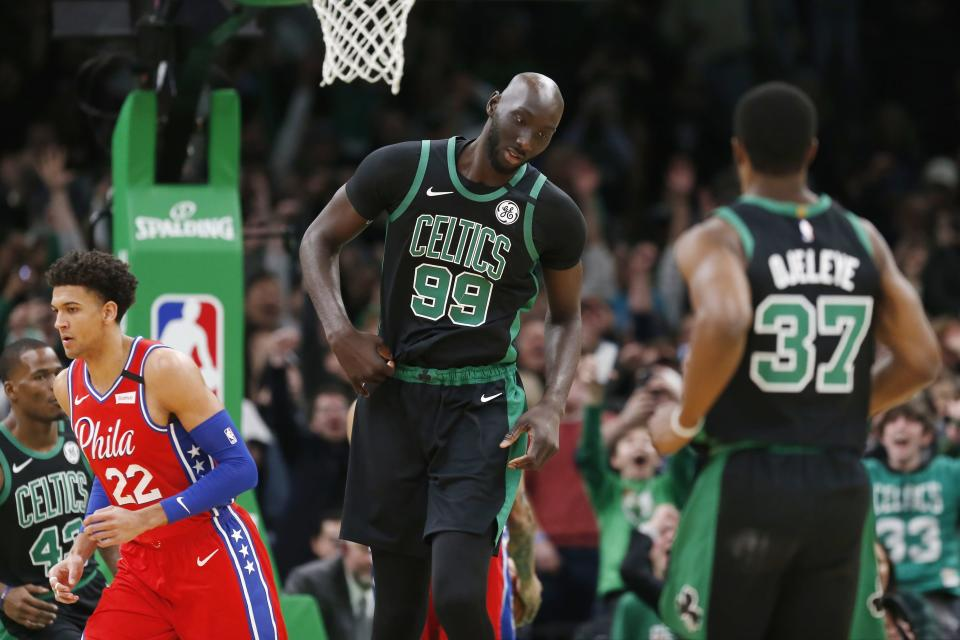 Boston Celtics' Tacko Fall (99) reacts after scoring during the second half of an NBA basketball game against the Philadelphia 76ers in Boston, Saturday, Feb. 1, 2020. (AP Photo/Michael Dwyer)