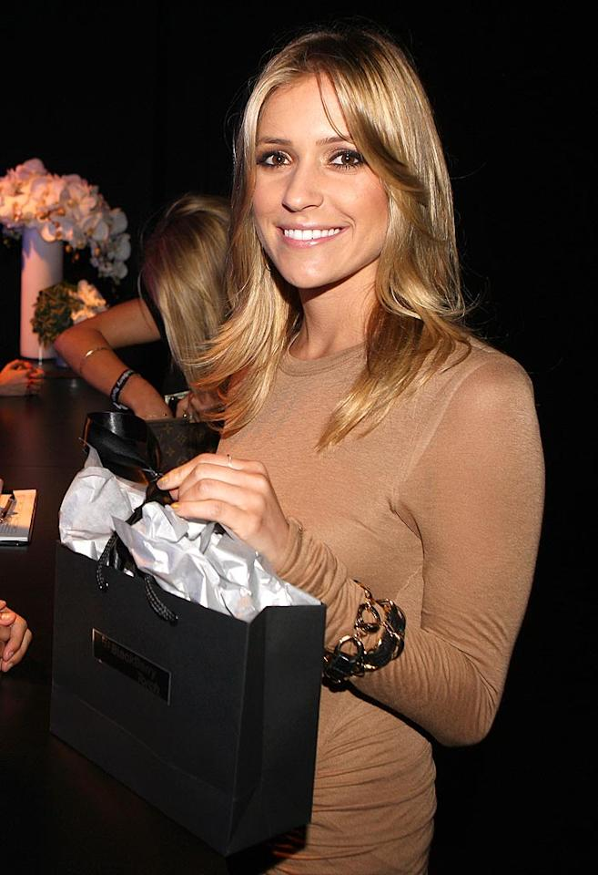 "Sporting a formfitting nude dress, former ""Hills"" starlet Kristin Cavallari was on hand to pick up her BlackBerry booty. Chris Weeks/<a href=""http://www.wireimage.com"" target=""new"">WireImage.com</a> - August 11, 2010"
